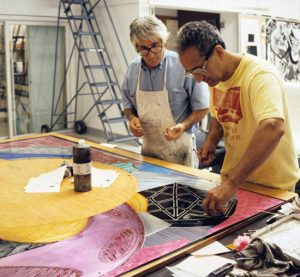 Frank Stella working on a print in his studio