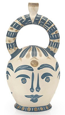 Picasso four aztec faces white ceramic pitcher with blue marking.